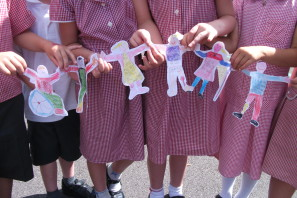 Pupils with their work for Send My Friend To School campaign